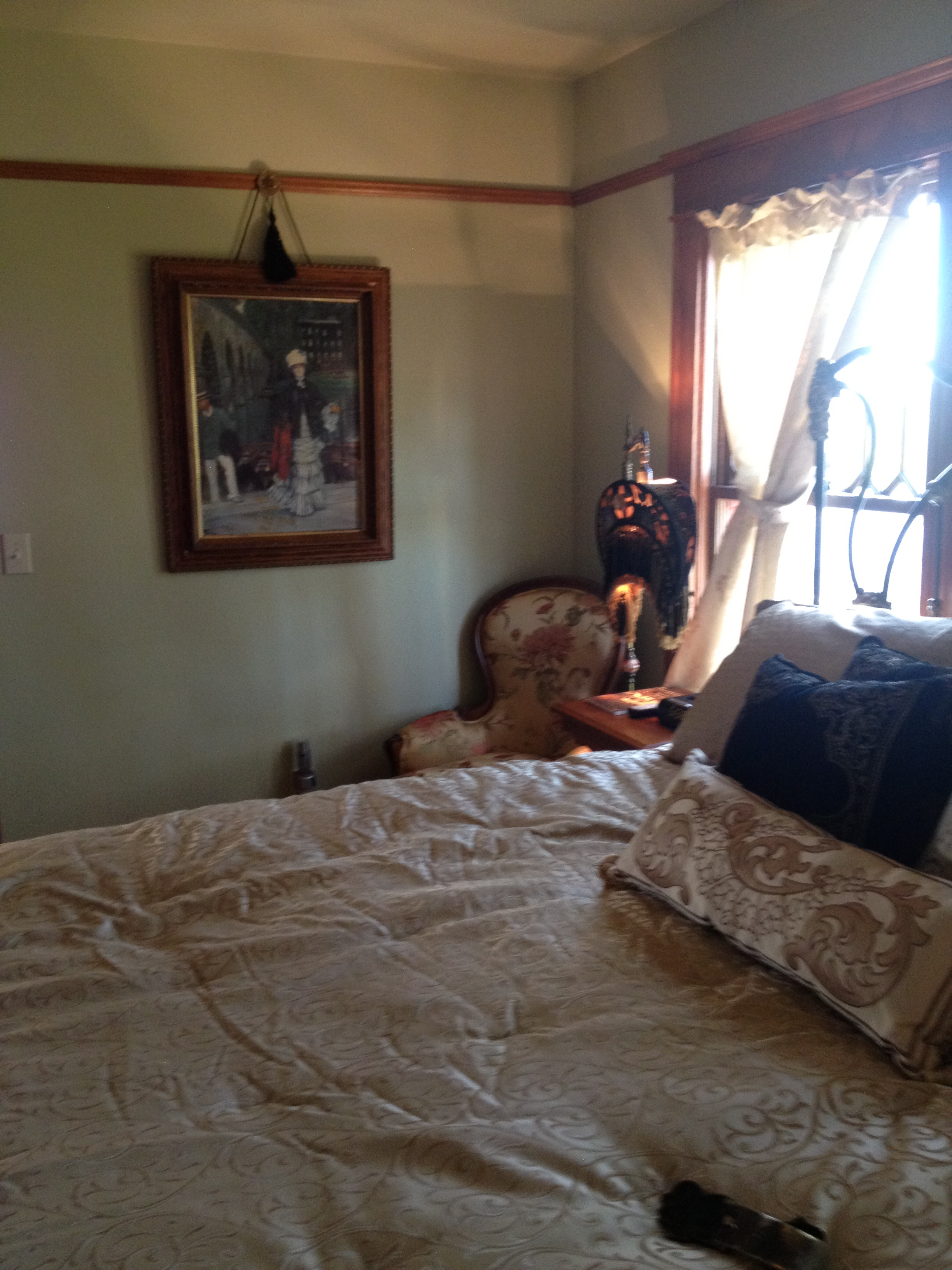 Prescott Victorian Master bedroom view of art and a chair